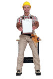 Worker holding clip-board Royalty Free Stock Photo