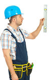 Worker holding construction bubble level Stock Image