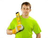 Worker holding construction level Stock Photos