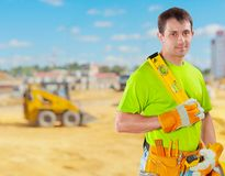 Worker holding construction lewel Royalty Free Stock Images