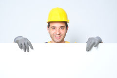 Worker holding a copy space cardboard for adv Stock Image
