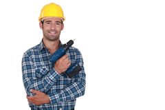 Worker holding cordless drill Stock Images