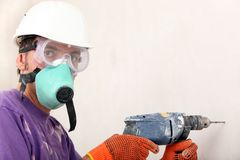 Worker holding drill Royalty Free Stock Image