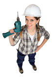 Worker holding a drill. Royalty Free Stock Photography