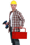 Worker holding drill Royalty Free Stock Photos
