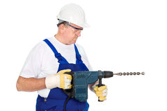 Worker holding drill for concrete Stock Image