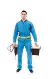 Worker holding a drill and a tool box Stock Images