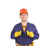 Worker holding ear muffs. Royalty Free Stock Photography