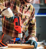 Worker holding an electric drill Stock Images
