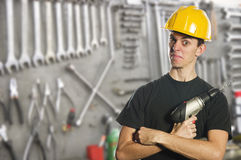 Worker holding electric drill Royalty Free Stock Photos