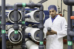 Worker holding an equipment in bottling plant Royalty Free Stock Photo