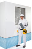 Worker holding a finishing insulation rasp Royalty Free Stock Photos