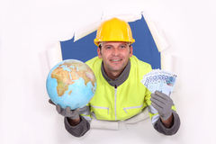 Worker holding a globe and money Stock Images