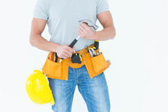 Worker holding hammer over white background Royalty Free Stock Photo