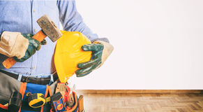 Worker holding a hammer Stock Photography