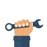 Worker holding in hand a spanner. Royalty Free Stock Photos