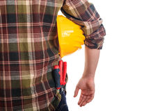 Worker holding a hard hat Royalty Free Stock Photography