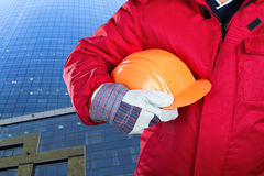 Worker holding hardhat Stock Photo