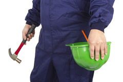 Worker holding a helmet and hammer Stock Photo