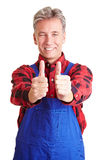 Worker holding his thumbs up Royalty Free Stock Photos