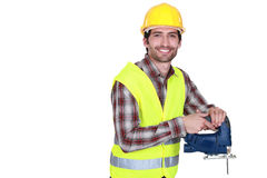 Worker holding a jigsaw Stock Photo