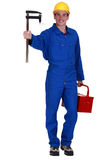 Worker holding measuring device Stock Photography