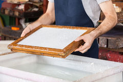 Worker Holding Mold At Paper Factory Stock Photo