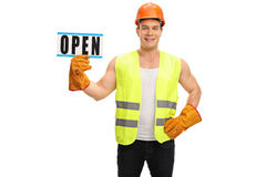 Worker holding an open sign Royalty Free Stock Photo