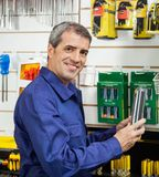Worker Holding Packed Product In Hardware Store Royalty Free Stock Photos