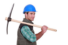 Worker holding a pickaxe. Royalty Free Stock Photography