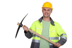 Worker holding pickaxe royalty free stock photo