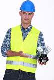 Worker holding piggy-bank Stock Images