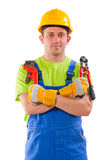 Worker holding  pipe wrench and steel cutter Stock Image