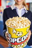 Worker Holding Popcorn Bucket At Cinema Royalty Free Stock Image