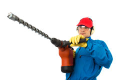 Worker holding a power drill. Worker with a hammer drill on white background Stock Photography