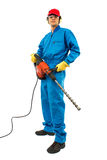 Worker holding a power drill. Worker man on a white background wearing protective equipment holding a pneumatic drill Royalty Free Stock Images