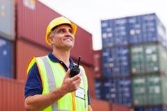 Worker holding radio Stock Image