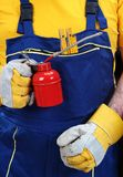 Man with oiler can. Worker holding red oiler can royalty free stock images