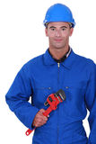 Worker holding red wrench Royalty Free Stock Images