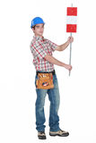 Worker holding road sign. Worker holding up road sign Royalty Free Stock Photo