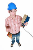 Worker holding a sander. Stock Images