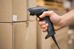 Worker holding scanner in warehouse Stock Images