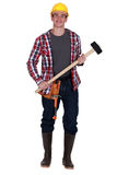 Worker holding sledge-hammer Royalty Free Stock Images