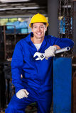 Worker holding spanner Stock Image