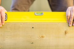 Worker Holding Spirit Level On Wood Outdoors Royalty Free Stock Image