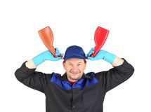 Worker holding spray bottles. Royalty Free Stock Photos