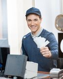 Worker Holding Tickets At Box Office Counter Stock Image