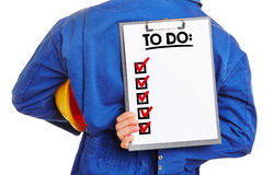 Worker holding To Do list on clipboard Stock Image