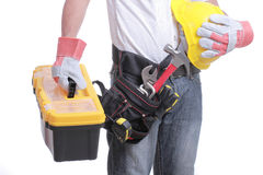 Worker holding tool box and hand glove with white background Royalty Free Stock Photography