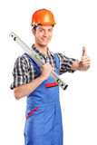 Worker holding a tool and giving thumb up Stock Images